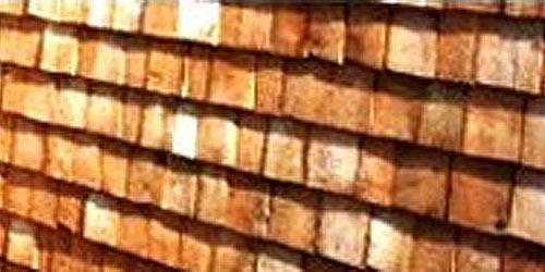 3-lags egespån, der er overfladebehandlet med lys trætjære